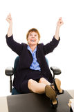 Businesswoman at Desk - Elated Royalty Free Stock Image