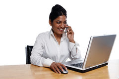 Businesswoman at Desk Multitasking Royalty Free Stock Images