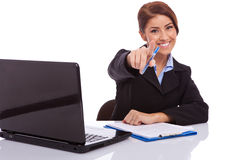 Businesswoman  at desk pointing Stock Image
