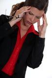 Businesswoman developing a headache Royalty Free Stock Photo