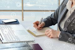 Businesswoman develops a plan for the Desk . Businesswoman develops a plan for the Desk in the office Stock Image