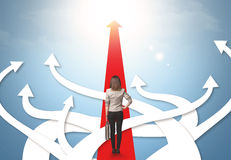 Businesswoman with different direction arrows Royalty Free Stock Images