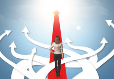 Businesswoman with different direction arrows Stock Photography