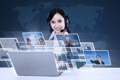 Businesswoman with digital photos on blue Stock Photos
