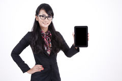 Businesswoman with Digital Tablet. Beautiful Businesswoman showing a Computer Tablet with a Blank Screen Royalty Free Stock Photo