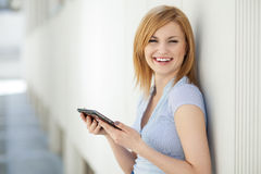 Businesswoman with digital tablet Stock Images