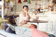 Businesswoman with digital tablet in a coffee shop Stock Images