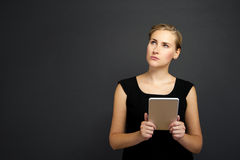 Businesswoman with Digital Tablet over dark background Stock Photos