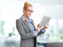 Businesswoman with digital tablet royalty free stock image