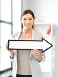 Businesswoman with direction arrow sign. Picture of attractive businesswoman with direction arrow sign Stock Photos