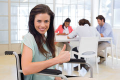 Businesswoman with disability gives thumbs up to camera Royalty Free Stock Image