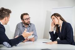 Businesswoman disagree with her colleagues on a meeting royalty free stock photo