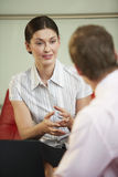 Businesswoman Discussing With Male Colleague Stock Photo