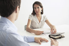 Businesswoman Discussing With Male Colleague Stock Photography