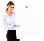 Businesswoman displaying a banner ad Stock Photography