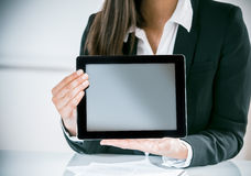 Businesswoman displaying a blank tablet Royalty Free Stock Image