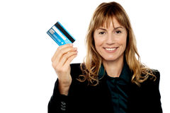 Businesswoman displaying cash card Stock Photo