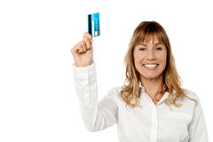 Businesswoman displaying cash card Stock Image