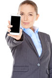 Businesswoman displaying her mobile phone Royalty Free Stock Images