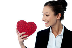 Businesswoman displaying her valentine gift Stock Photos