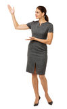 Businesswoman Displaying An Imaginary Product Royalty Free Stock Photo