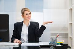 Businesswoman displaying invisible product Stock Photos