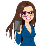 Businesswoman Displaying Vertical Smartphone. Beautiful brunette businesswoman displaying smartphone on vertical position Royalty Free Stock Photography