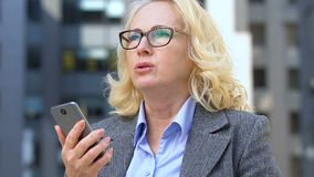 Businesswoman dissatisfied with slow mobile internet, failed file sharing on app. Stock footage stock footage