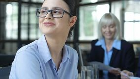 Businesswoman distracted from conference, dreaming of travelling, vacations