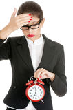 Businesswoman in distress. Young businesswoman with a red clock in distress. Isolated on white Stock Photos