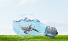 Businesswoman diver. Concept image Stock Photo
