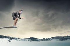 Businesswoman diver. Concept image Stock Photos
