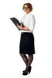 Businesswoman with a document folder Stock Photos