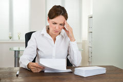 Businesswoman With Document In Office Royalty Free Stock Images