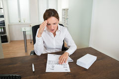 Businesswoman With Document In Office Stock Photo