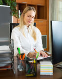 Businesswoman with documents and computer stock image