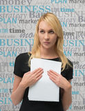 Businesswoman with documents. Businesswoman holding documents, close up Royalty Free Stock Images