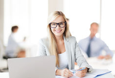 Businesswoman with documents in office Royalty Free Stock Photos