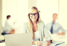 Businesswoman with documents in office Royalty Free Stock Images