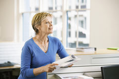 Businesswoman With Documents In Office Royalty Free Stock Image