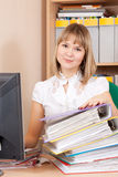 Businesswoman with documents  working in office Stock Photos