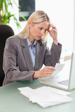 Businesswoman doing accounting Stock Images