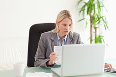 Businesswoman doing calculations Stock Image