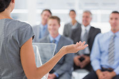 Businesswoman doing conference presentation. In meeting room stock photo