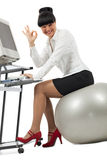 Businesswoman doing exercise with a ball Stock Image