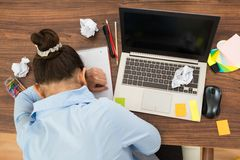 Businesswoman doing head down on desk Royalty Free Stock Photography
