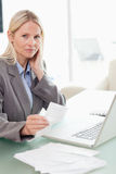 Businesswoman doing her accounting Stock Images