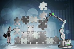 The businesswoman doing jigsaw puzzle with robotic arm Royalty Free Stock Photos
