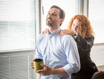 Businesswoman doing massage to her colleague stock photography
