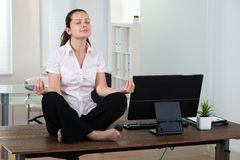 Businesswoman Doing Meditation Stock Photography
